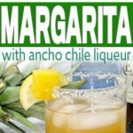 closeup of a glass of smoky spicy pineapple margarita with lemon and pineapple around it
