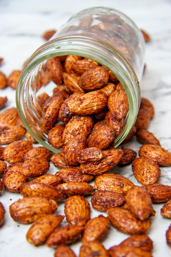 BBQ almonds, low carb spiced nut snack, spilling out of a mason jar