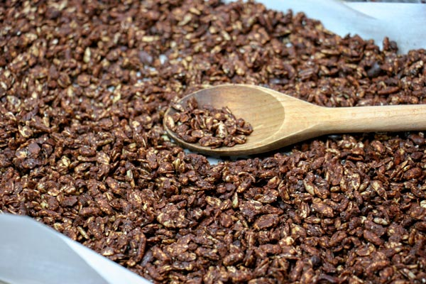 pan of chocolate granola with wooden spoon