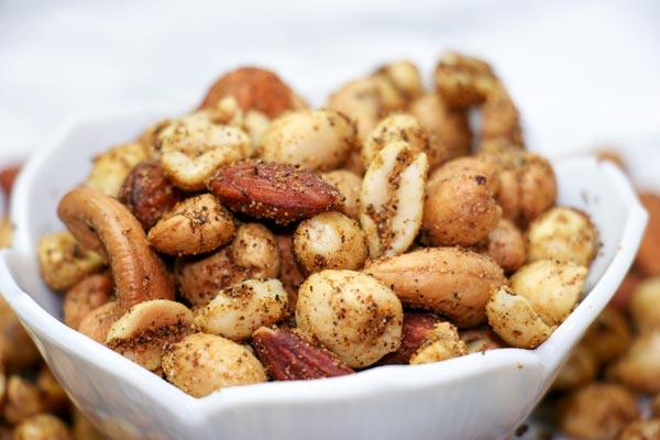 garlic herb spiced nut mix in flower bowl