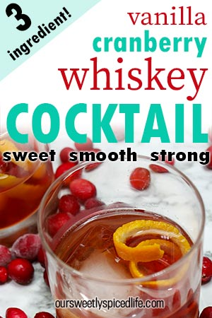 topdown of a glass of vanilla cranberry whiskey cocktail garnished with an orange twist