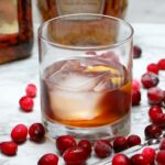 rocks glass of vanilla cranberry whiskey cocktail