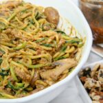 bowl of zoodle pesto pasta with mushrooms vegan lunch or dinner
