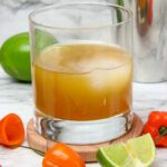 glass of mango whiskey cocktail with habanero