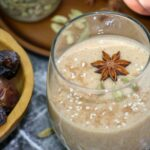 closeup of a glass of spiced date smoothie