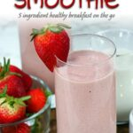 frozen strawberry smoothie with fresh strawberries around