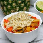 bowl of tropical vegan pineapple curry with rice on top