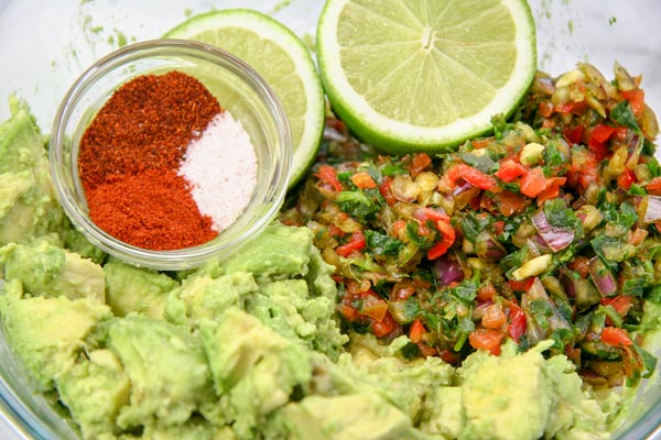 guacamole ingredients - advance prep mix ins, avocado chunks, spices, lime