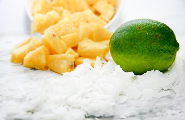 coconut flakes, lime, and pineapple for pineapple lime flavored coconut chips