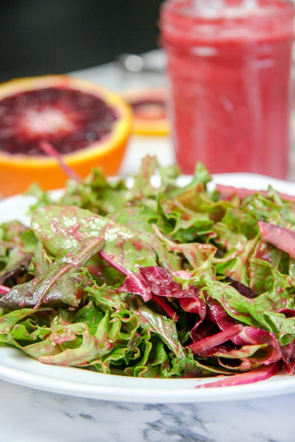 up close plate of side salad with orange raspberry dressing homemade