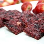 strawberry cherry apple chia raw fruit bars on plate