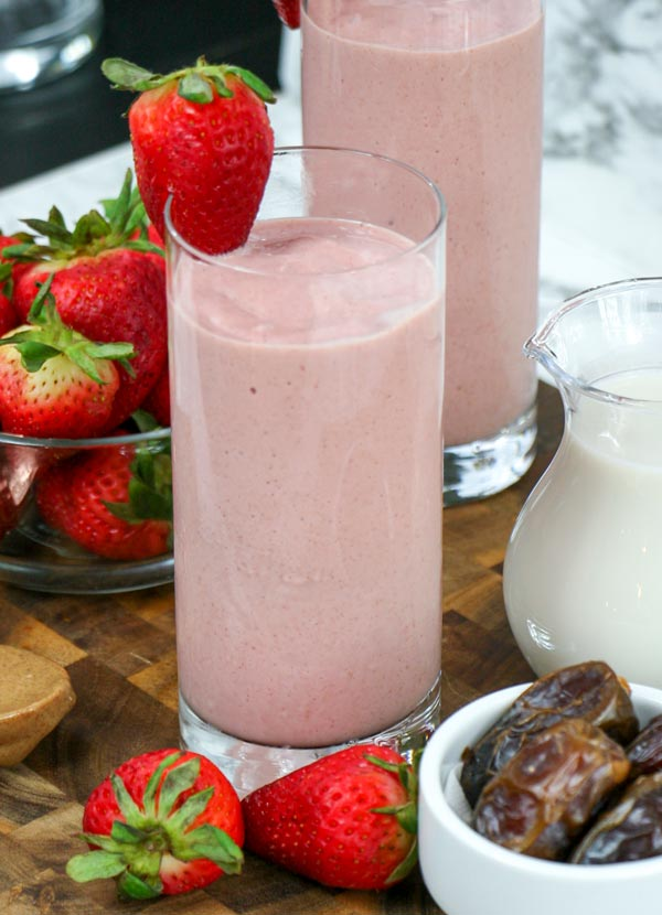 highball glass of strawberry smoothie without yogurt or banana