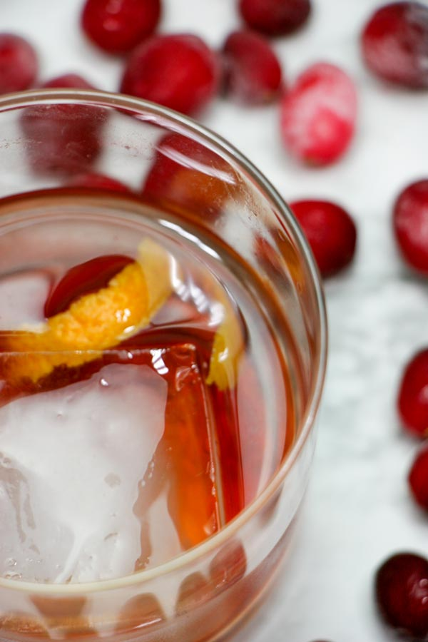 closeup of a glass of vanilla cranberry whiskey red snapper cocktail