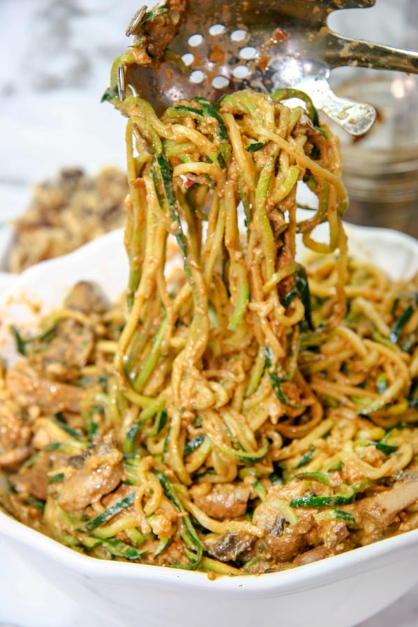 sundried tomato walnut pesto over zucchini noodles or zoodles with garlic mushrooms