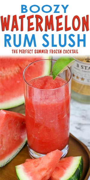 boozy watermelon slush garnished with a lime wedge and next to some fresh watermelon