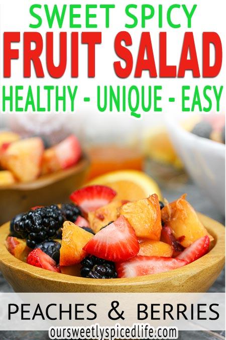 bowl of sweet spicy fruit salad tossed in a honey orange sriracha dressing